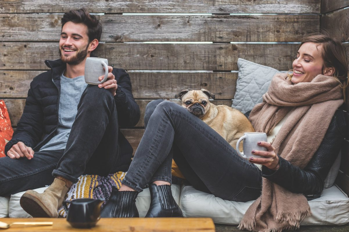 couple relaxing with dog and coffee